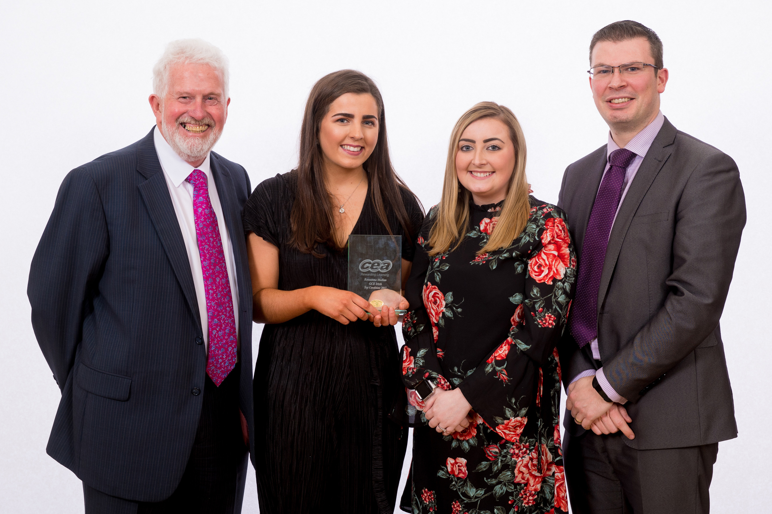 CCEA Chairman Trevor Carson pictured with Roseanna Mullan who was placed First in Irish at A-Level and her teachers Miss M. McGouran and Mr W. Mcphillomey.