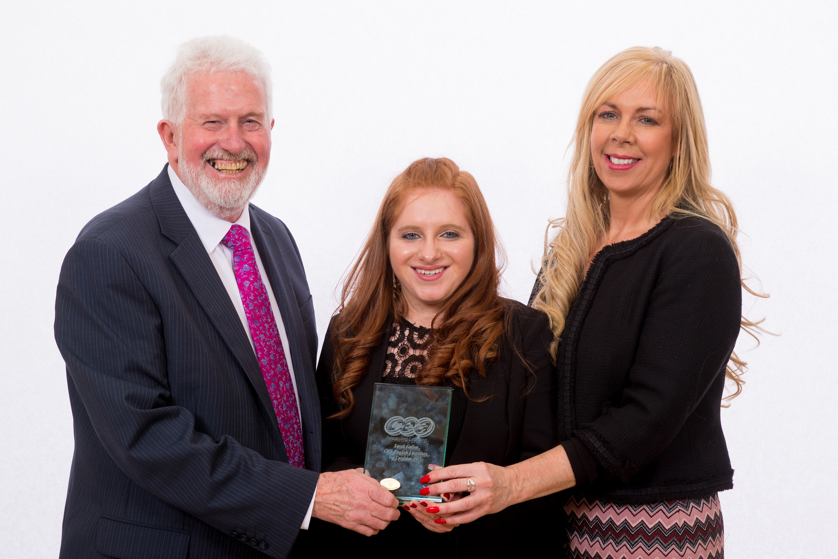 CCEA Chairman Trevor Carson and Principal Ms D. Gillespie are pictured with Sarah Gallen who was placed joint First in English Literature at A-Level.