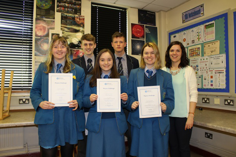 Ms P Bolger pictured with some of the Year 12 pupils.