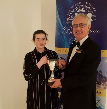 Roma is presented with the Newcombe Cup