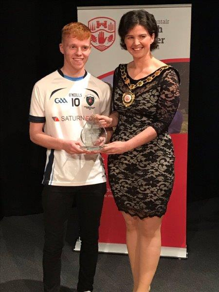 Adam Connolly accepts the award on behalf of the MacRory Team.